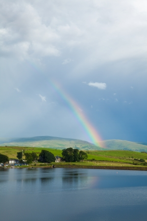 boathouse: rainbow over a lake, boathouse Stock Photo