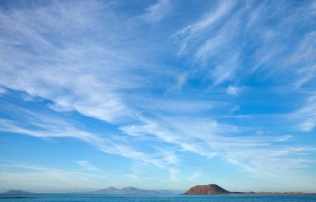 predominantly: Fuerteventura, view towards Isla de Lobos and Lanzarote, natural background of predominantly sky