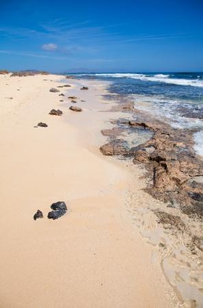 burro: Fuerteventura, edge of Burro beach, volcanic rocks in transparent water