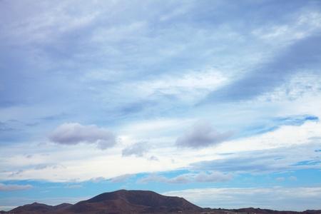 predominantly: Fuerteventura, view towards extinct volcano Bayuyo, natural background of predominantly sky