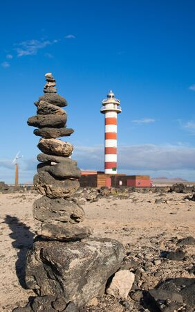 Toston lighthouse and stone cairn close to El Cotillo, Fuerteventura Stock Photo - 15803928