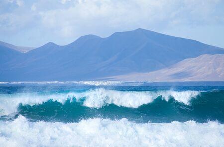swell: Sea swell btween Fuerteventura and Lanzarote - Playa blanca area of Lanzarote in the background Stock Photo
