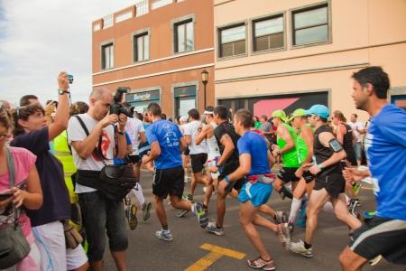 CORRALEJO - NOVEMBER 03: Runners start the race at Fourth international Fuerteventura half-marathon 03 November, 2012 in Corralejo, Fuerteventura, Spain Stock Photo - 16224657