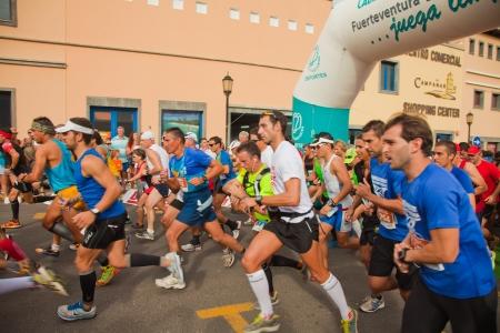 CORRALEJO - NOVEMBER 03: Runners start the race at Forth international Fuerteventura half-marathon 03 November, 2012 in Corralejo, Fuerteventura, Spain Stock Photo - 16224658