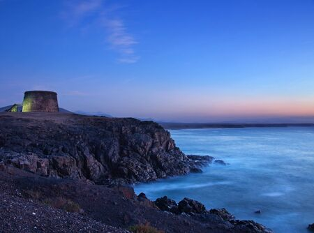 fortification: Northern Fuerteventura, edge of El Cotillo, Fortification tower Stock Photo