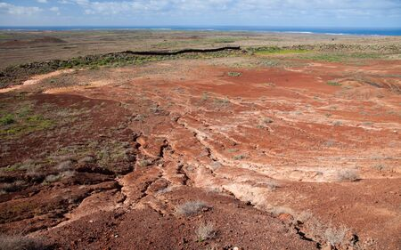 hondo: Northern Fuerteventura, view from Caldern Hondo to the lower planes of red earth, cut through by winter rain currents