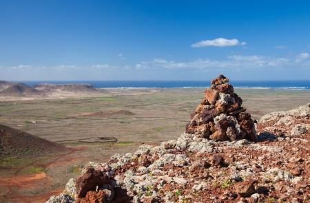 hondo: red volcanic rock cairn on the edge of Calderon Hondo, Northern Fuerteventura
