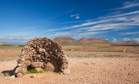 Inland Fuerteventura, Canary Islands, traditional dry stone wind shelter for shepherds,  Stock Photo - 16881460
