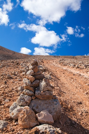 road conditions: Inland Fuerteventura, Canary Islands, volcanic malpais (badlands), path up and a cairn marker