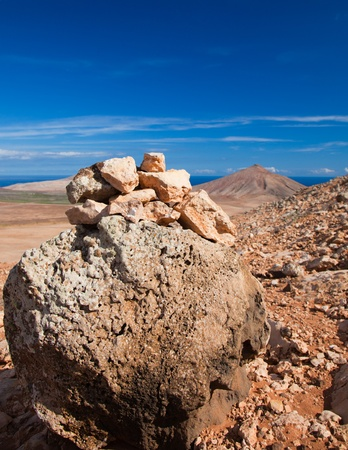 Inland Fuerteventura, Canary Islands, volcanic malpais (badlands), path  and a cairn marker photo