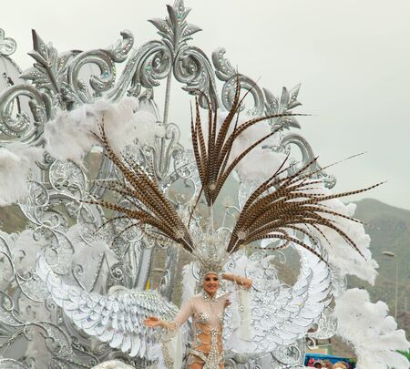 canary isalnds: SANTA CRUZ, SPAIN - February 12: queen of the carnival greets the viewers at  the parade for one of the most important carnivals in the world on February 12, 2013 in Santa Cruz de Tenerife, Spain Editorial
