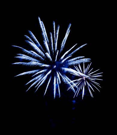 multiple fireworks blasts on black background photo