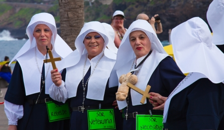 canary isalnds: PUERTO DE LA CRUZ, SPAIN -  participants prepare and assemble for the main carnival parade  in Puerto de la Cruz, Tenerife, Spain