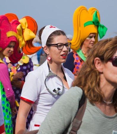 canary isalnds: PUERTO DE LA CRUZ, SPAIN - February 16: participants prepare and assemble for the main carnival parade on February 16, 2013 in Puerto de la Cruz, Tenerife, Spain