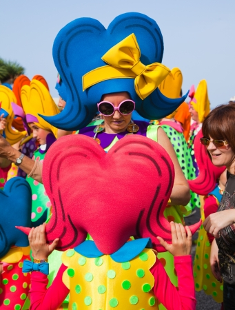 PUERTO DE LA CRUZ, SPAIN - February 16: participants prepare and assemble for the main carnival parade on February 16, 2013 in Puerto de la Cruz, Tenerife, Spain Stock Photo - 18468890