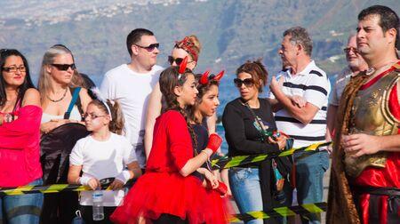 PUERTO DE LA CRUZ, SPAIN - February 16: Colorfully dressed participants take part in main carnival parade on February 16, 2013 in Puerto de la Cruz, Tenerife, Spain Stock Photo - 18471343