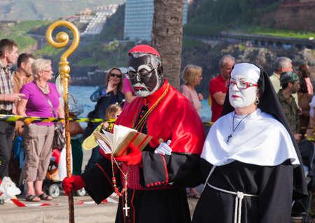 PUERTO DE LA CRUZ, SPAIN - February 16: Colorfully dressed participants take part in main carnival parade on February 16, 2013 in Puerto de la Cruz, Tenerife, Spain Stock Photo - 18471338