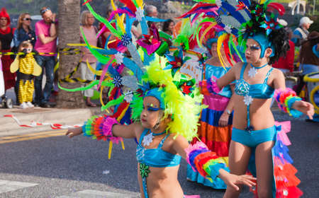 canary isalnds: PUERTO DE LA CRUZ, SPAIN - February 16: Colorfully dressed participants take part in main carnival parade on February 16, 2013 in Puerto de la Cruz, Tenerife, Spain