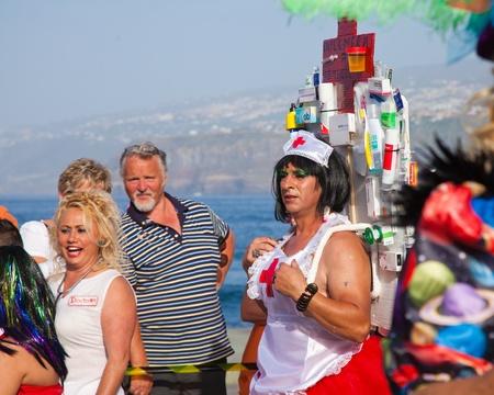 PUERTO DE LA CRUZ, SPAIN - February 16: Colorfully dressed participants take part in main carnival parade on February 16, 2013 in Puerto de la Cruz, Tenerife, Spain Stock Photo - 18535853