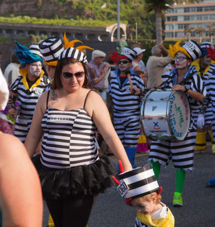 PUERTO DE LA CRUZ, SPAIN - February 16: Colorfully dressed participants take part in main carnival parade on February 16, 2013 in Puerto de la Cruz, Tenerife, Spain Stock Photo - 18535847