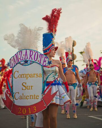 CORRALEJO, SPAIN - MAR 16: unidentified participants take part in the main carnival parade on March 16, 2013 in Corralejo, Fuerteventura, Spain Stock Photo - 18535868