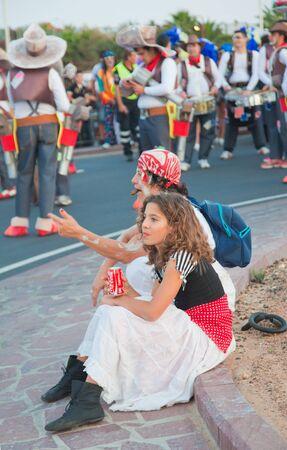 canary isalnds: CORRALEJO, SPAIN - MAR 16: unidentified participants take part in the main carnival parade on March 16, 2013 in Corralejo, Fuerteventura, Spain