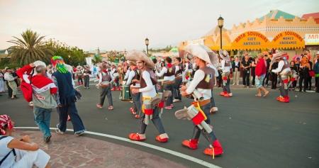 CORRALEJO, SPAIN - MAR 16: unidentified participants take part in the main carnival parade on March 16, 2013 in Corralejo, Fuerteventura, Spain Stock Photo - 18535843