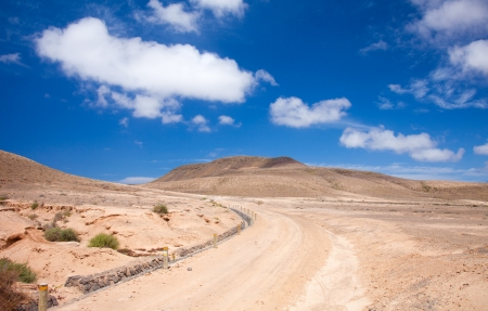 Inland Northern Fuerteventura, around Lajares, path in  Majada de la Pila, protected area for steppe birds Stock Photo - 19056942