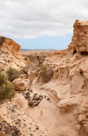 desolated: Inland Northern Fuerteventura, barranco - dry river bed - close to  Lajares Stock Photo
