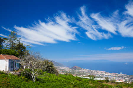 Northern  Tenerife, view over Puerto de La Cruz towards La Palmaon the horizon photo