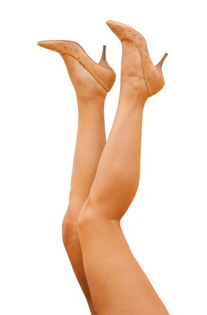 sporty female legs in tan shoes Stock Photo - 19723031