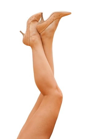 sporty female legs in tan shoes Stock Photo - 19723041