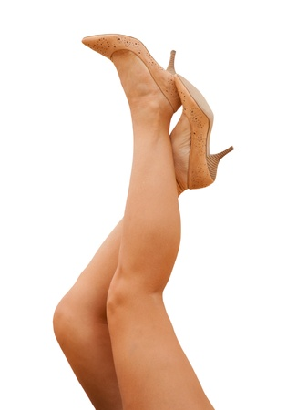 sporty female legs in tan shoes photo