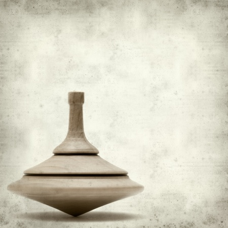 textured old paper background with spinning top photo