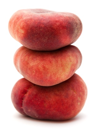 doughnut peaches isolated on white photo