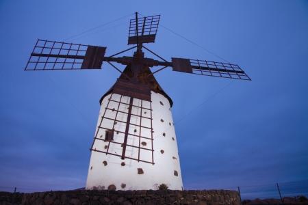 oliva: Northern Fuerteventura, traditional round windmill (molino), evening light