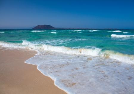 foaming: Northern Fuertevenura, Corralejo Flag Beach, Isla de Lobos in the background