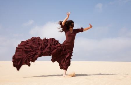 flowing: Flamenco dancer in the long dress in the dunes