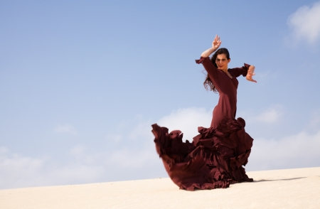 surrounding: Flamenco dancer in the long dress in the dunes