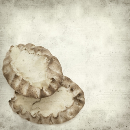 textured old paper background with karelian pasty photo
