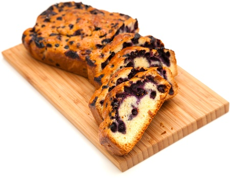 blueberry cake on wooden board, isolated on white  photo