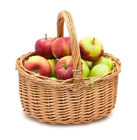 wicker basket full of apples isolated on white Stock Photo