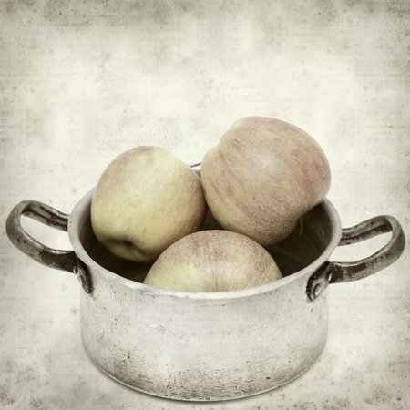 textured old paper background with apples in aluminium pan photo