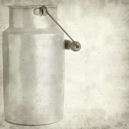 textured old paper background with aluminium milk pail photo