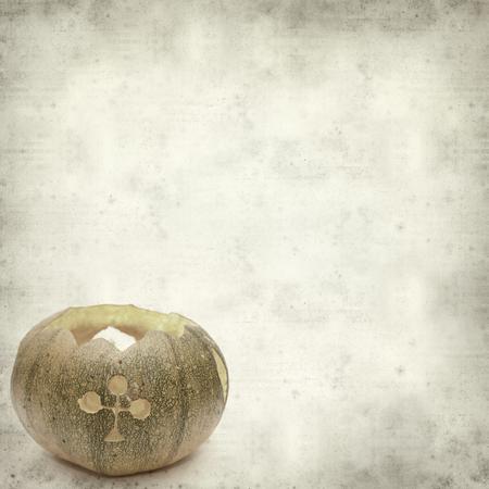 textured old paper background with carved pumpkin Banco de Imagens