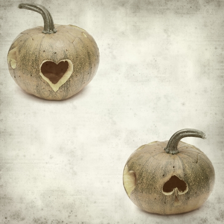 textured old paper background with carved pumpkin photo