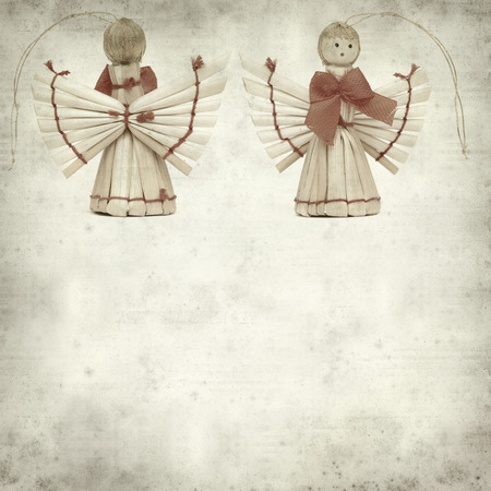 textured old paper background with straw angel photo