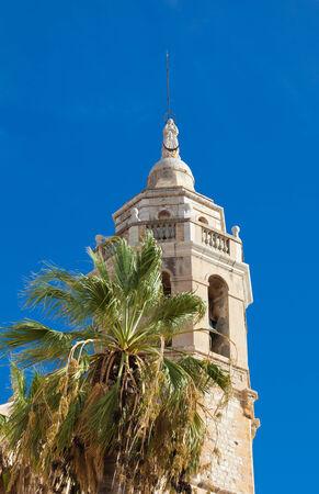 17th century: Sitges, 17th century seaside church of Sant Bartomeu i Santa Tecla, main tower