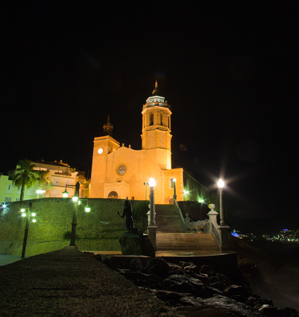 17th: Sitges, 17th century seaside church of Sant Bartomeu i Santa Tecla Stock Photo