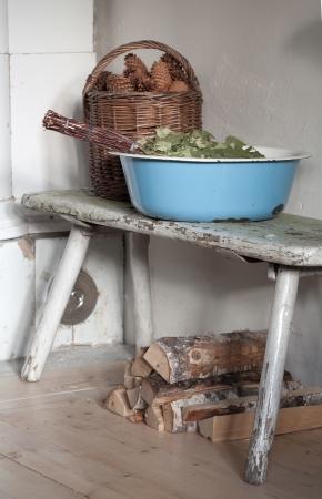 kindling: preparing for sauna  - still life with enamelled tub, sauna besom, kindling and firewood Stock Photo